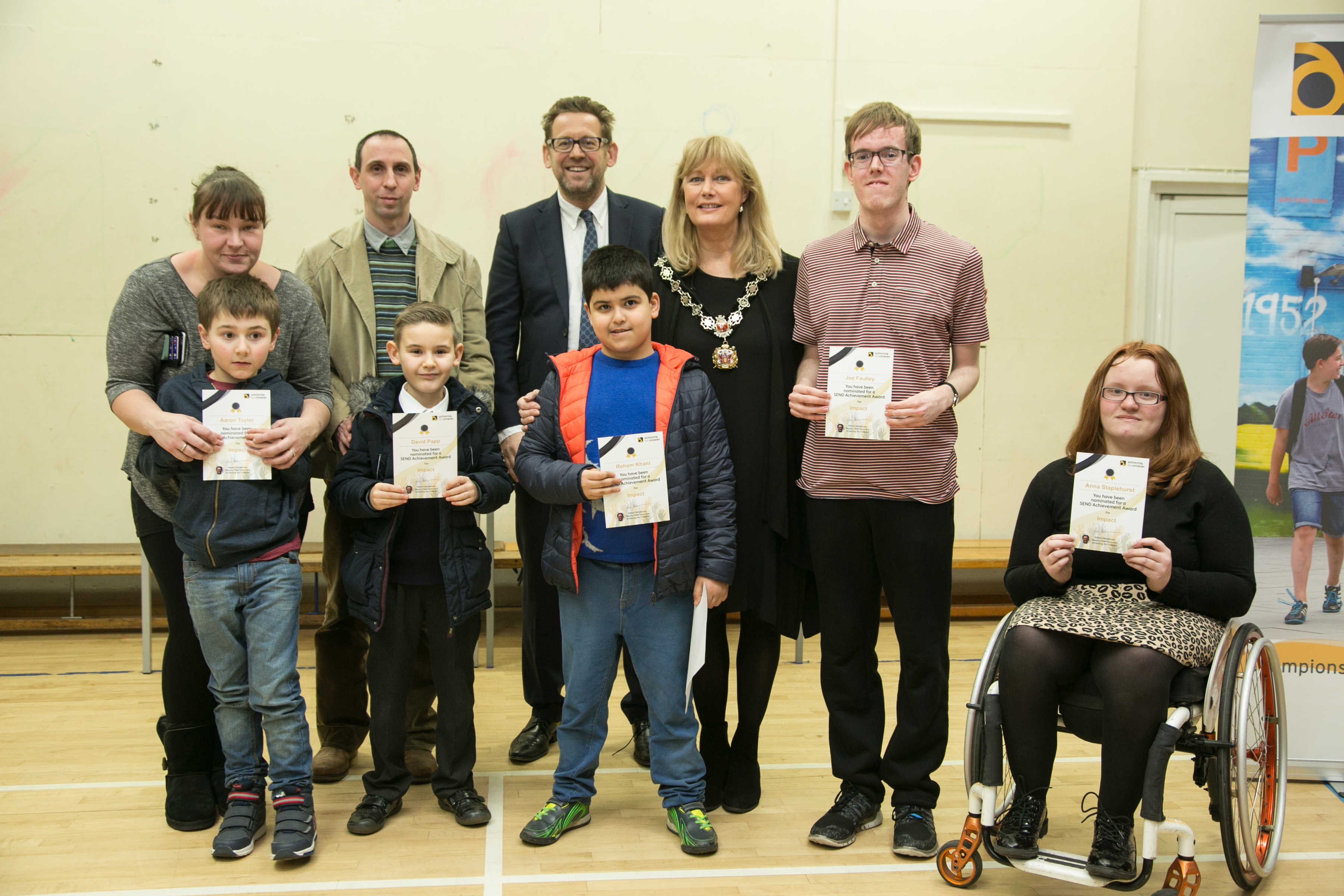 _centre__Rob_Henderson__Director_of_Children_s_Services_at_AfC__stands_with_Deputy_Mayor_of_Richmond__Cllr_Kate_Howard__and_the_nominees_in_the__impact__category_and_family_members.